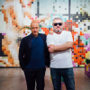 (from right) artist Tobias Rehberger with Sam Keller, Director of the Fondation Beyeler in front of Tobias Rehberger, 1661-1910 from Nagasaki, Meiji, Setti, 2015 at Art Basel Miami Beach 2015; photograph by Marco Andres Argüello